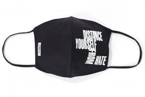"GMHC mask that says ""distance yourself from hate"""