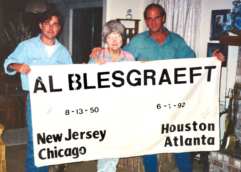 Frank Godchaux (left) holds a panel for the NAMES Project AIDS Memorial Quilt in 1994 with Doris and David Bruce in remembrance of his deceased boyfriend, Al Blesgraeft.